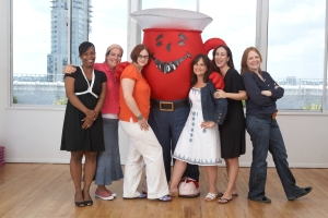 New York moms sans kids pose for a photo up with Mr. Kool-Aid